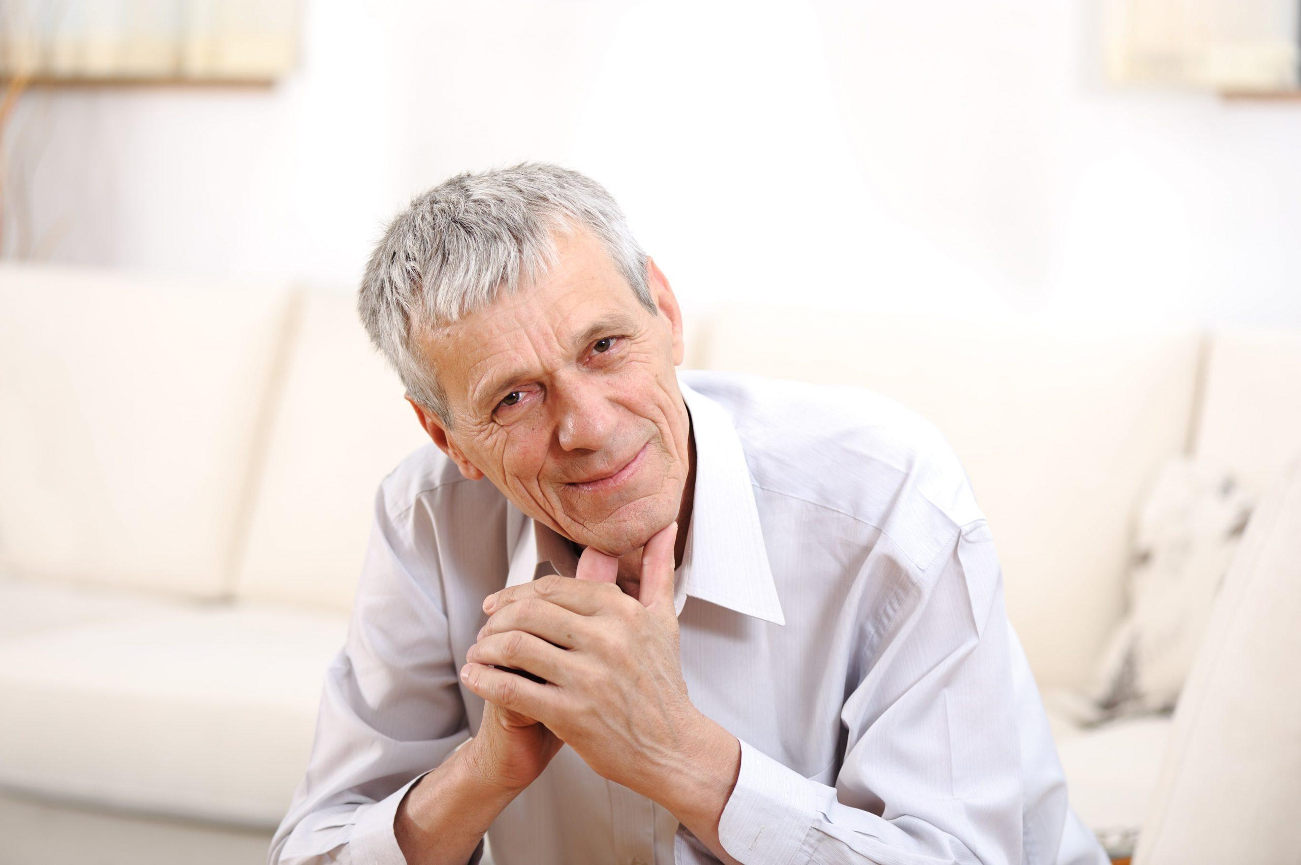 happy-relaxed-elderly-man-on-sofa